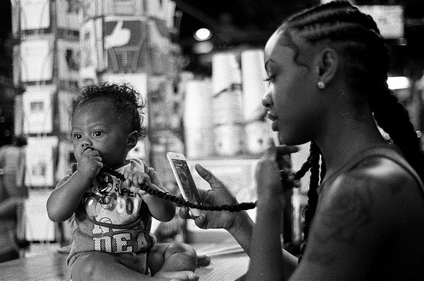 Real Charlotte Observer: Barnhardt's documentary photography: black and white, 35mm film from August 2017 of a moment at Common Market in Plaza Midwood.