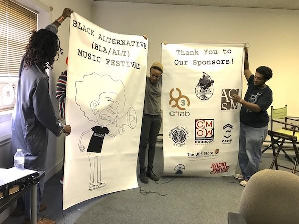 Singer Ali Steele (from left), LeAnna Eden and SiFi unveil the Bla/Alt backdrops inside Umbrellamindz' HQ at Camp North End.