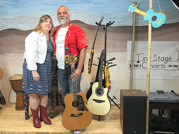 Karen Butler and Louis Beeler on their tiny stage. (Photo by Mark Kemp)