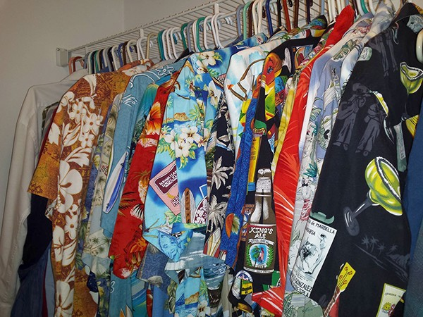 Beeler's closet full of TSC uniforms: dozens of gaudy Hawaiian shirts.