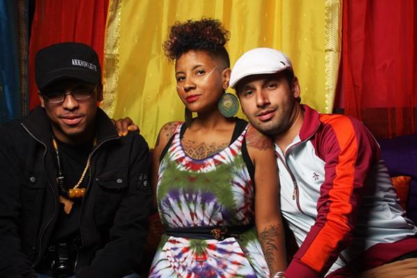 Jasiatic (center) and friends  at a 2011 Su Casa event. (Photo courtesy of Su Casa)