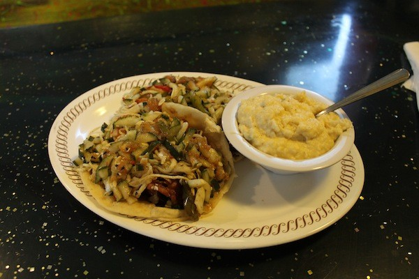A Krazy Fish favorite: salmon tacos with jalapeno cheddar grits.