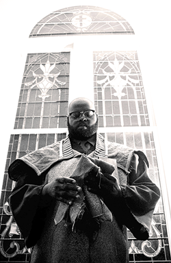 Preacher Talley in black and white. (Photo by Jamar Bleusol Caldwell)