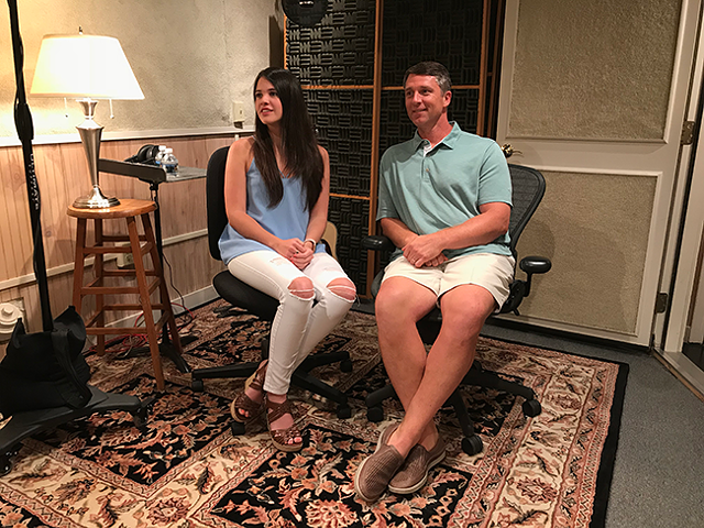 Proud father John Kasay (right) sits with daughter Savannah at SoundPost Productions studio in Charlotte. (Photo by Mark Kemp)