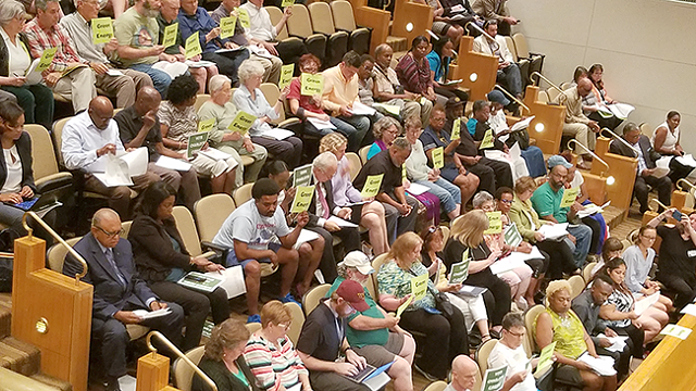 Many residents showed up to the Charlotte City Council meeting on June 25 to show support for a resolution to reduce carbon emissions. The resolution passed unanimously. (Photo by Rhiannon Fionn)