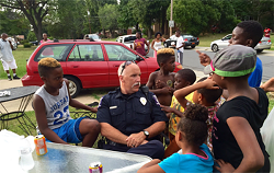 Several children gather around a police officer during a community event. (Courtesy of City of Charlotte)