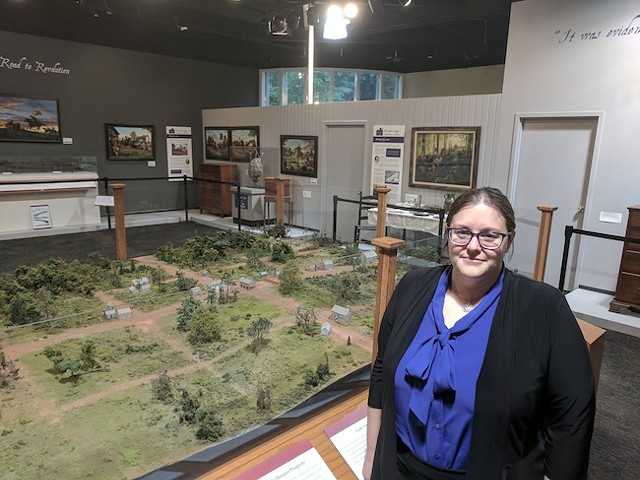 Adria Focht with a model of Uptown Charlotte, circa late 1700s.