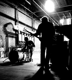 Joules jams in an empty warehouse. (photo courtesy of Joules)