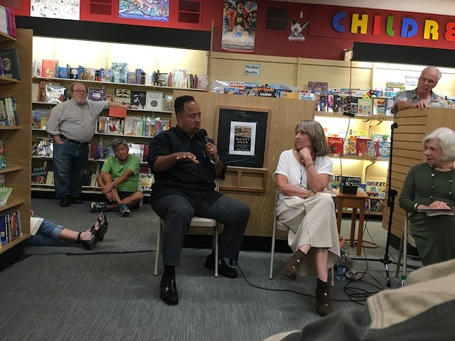 Belton Platt (left) with Pam Kelley at a recent event at Park Road Books. (Photo by Neel Stallings)