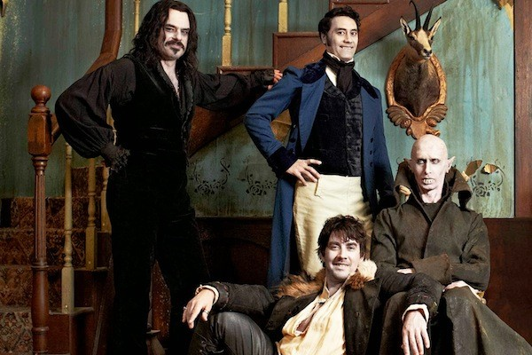Jemaine Clement, Taiki Waititi (both standing), Jonathan Brugh and Ben Fransham in What We Do in the Shadows (Photo: Paramount)