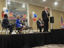 Mayor Dan Clodfelter, pictured with other Democratic mayoral candidates, addresses the crowd at the LGBT Community Candidate Forum in early August. - PHOTO BY RYAN PITKIN