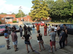 Activists prepare to leave their rallying point to carry out Funeral Friday. - PHOTO BY RYAN PITKIN