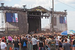Crowds swarm in front of one of the main stages at Carolina Rebellion. - JEFF HAHNE