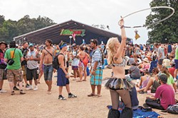 Fans soak in the sun and sounds from one of the side stages at Bonnaroo in 2013. - JEFF HAHNE