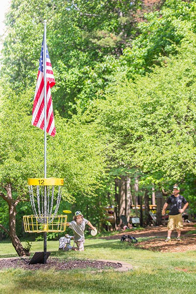 Players approach Hole 12 at Brackett's Bluff during a recent fundraiser tournament for the family of a regular at Brackett's who had passed away. (Photo by Brian Twitty)