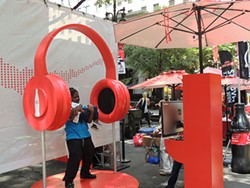 Folks posed for pictures with these headphones only after handing over their phone number. (Photo by Ryan Pitkin)