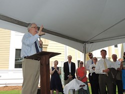 Dale Mullinnex addresses a crowd of Housing First Charlotte-Mecklenburg supporters at a recent celebration and tour of the expansion. - RYAN PITKIN