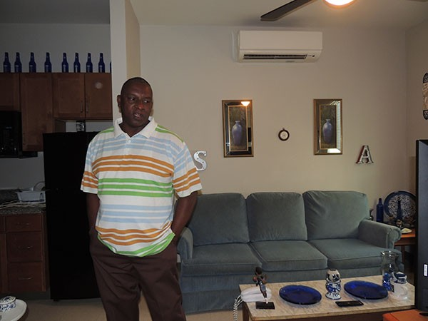 Sam Anthony in the Moore Place apartment he's lived in for nearly four years. He will be looking at moving out on his own soon. - RYAN PITKIN