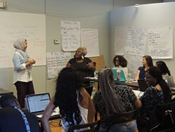Na'ilah El-Amin listens to feedback during a canvassing workshop. (Photo by Ryan Pitkin)