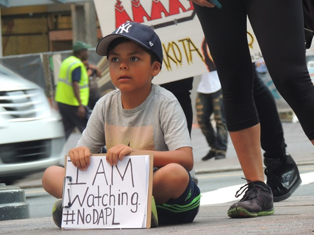 A 9-year-old boy at Tuesday's protest. - RYAN PITKIN