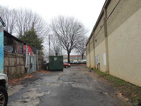 An alleyway next to Snug Harbor is oft-used as a shortcut during late-night hours. Some neighbors would like to see more lighting in spots like this. - RYAN PITKIN