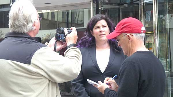 Charlotte School of Law student Margaret Kocaj speaks to reporters in front of the school. She's demanding the school's president and head dean be fired following recent investigations. - RHIANNON FIONN.