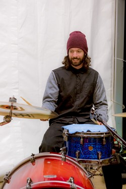 "Drummer Patrick Buckley believes ""100 percent in Octavia's vision"""