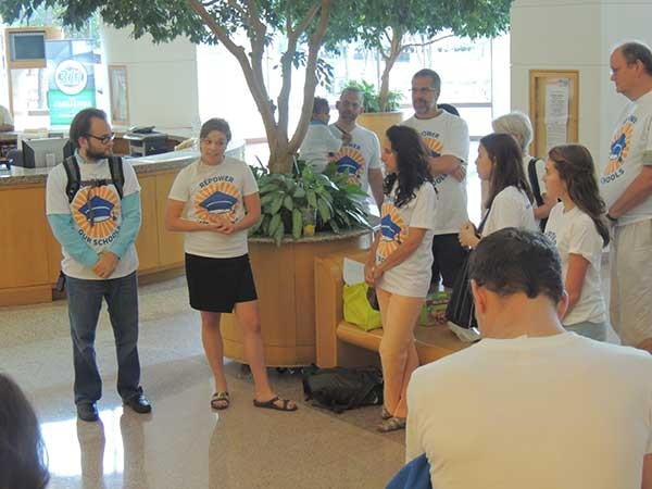 Hanna Mitchell (second from left) addresses a group of advocates at a CMS board meeting in August 2015, in Repower Our Schools' early days. - RYAN PITKIN