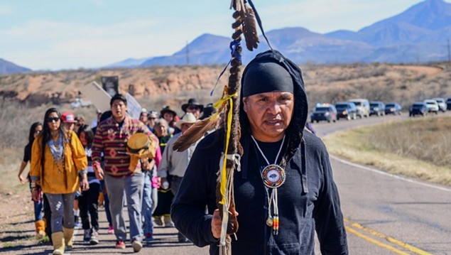 Wendsler Nosie, Sr., leads a march from the San Carlos Apache Reservation to a sacred and now endangered site called Oak Flat. - COURTESY OF APACHE STRONGHOLD