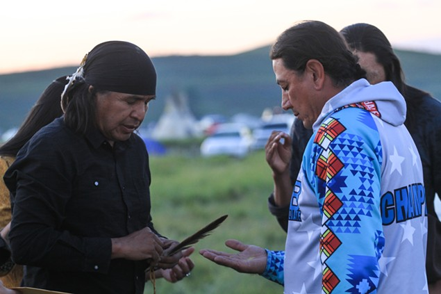 Wendsler Nosie, Sr., (left) prays with Standing Rock chairman David Archambault II during a 2016 visit to show solidarity with tribes and protesters opposing the Dakota Access Pipeline. - ALLIE FREDERICKS