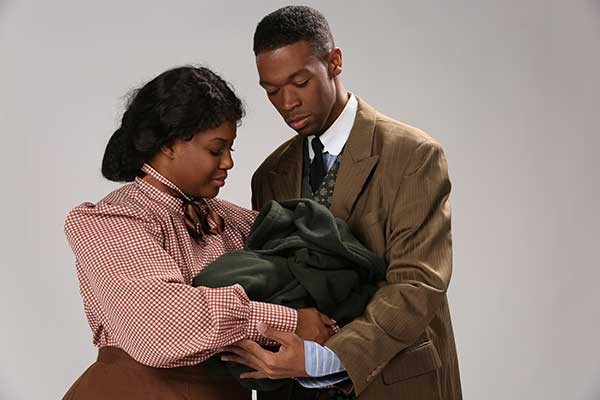 Brittaney Currie, as Sarah, and Tyler Smith, as Coalhouse. - COURTESY OF CPCC