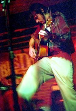Seth Avett of the Avett Brothers kicks it at the Double Door - DANIEL COSTON
