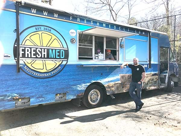 Fresh Med is a relatively new food truck that's made a big splash. The owner, Tyler Lee, is standing; in the window is Chris Alves, the chef. - MICHAEL ROSEN