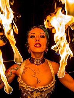 Collette Ellis plays with fire. - ANDREW DOLAN