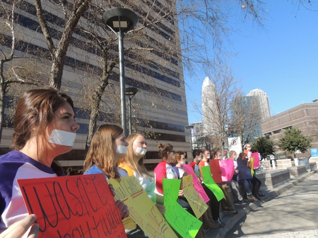 Students with Campus Pride protest the recent action of city leaders and inaction of state leaders on Dec. 22 in Charlotte. (Photo by Ryan Pitkin)