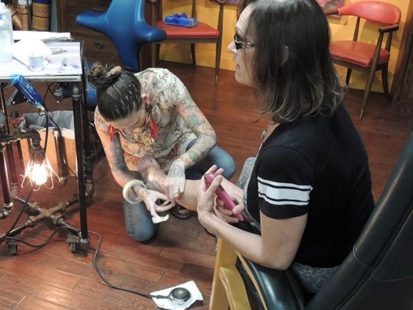 Moran tattoos Alli Plyler. - MELISSA MCHUGH