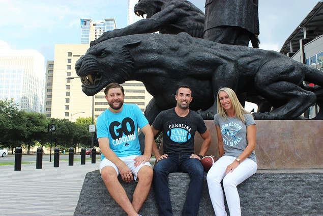 JD Harris (middle) shows off some Glory Days Apparel tees with friends.