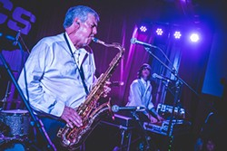 Lind wails away on his saxophone. (Photo by Bobbi Barbarich)