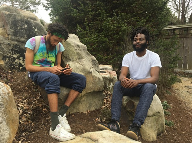 Amitabha (left) both plugged in and blissed out on a nature walk with rapper Black Linen. (Photo by Mark Kemp)