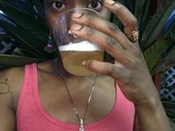 Ekua Adisa McRae with a Black Star Line beer.