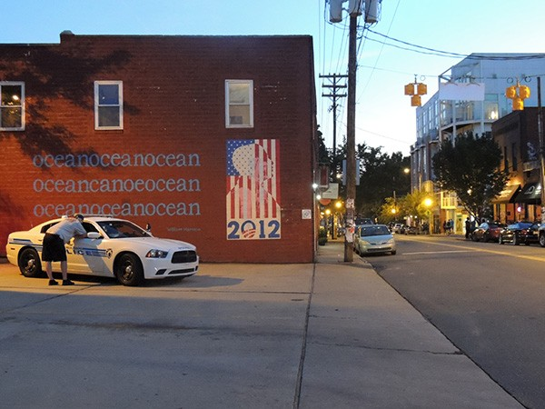 A police car hangs out in NoDa on May 31, the first night of foot patrols in the neighborhood.