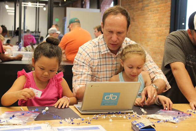 """Families gathered at Google Fiber recently for Digi-Bridge's """"Daddy Daughter Code-In"""" event."""