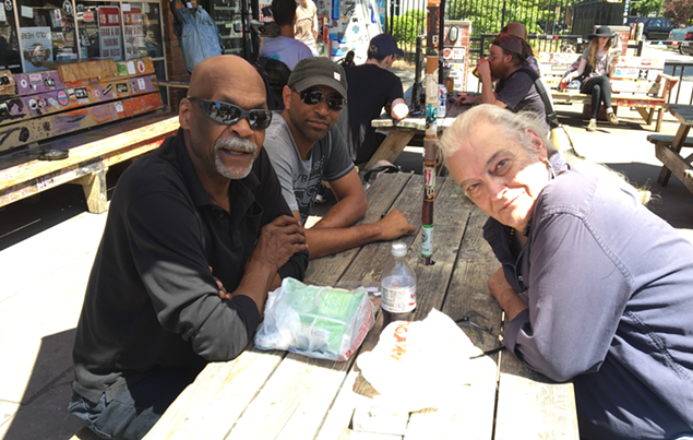 The core original members last month at Common Market in Plaza Midwood. From left: Blackwell, Lindsay and Brock. (Photo by Mark Kemp)