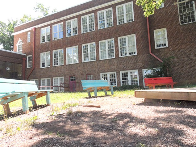 Benches sit empty outside the present-day Morgan School. (Photo by Ryan Pitkin)