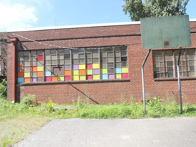 A basket-less basketball goal at the present-day Morgan School site. (Photo by Ryan Pitkin)