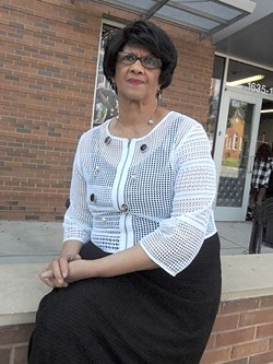 Dorothy Counts-Scoggins today, sitting outside of Mosaic Village, near her west Charlotte home. (Photo by Ryan Pitkin)