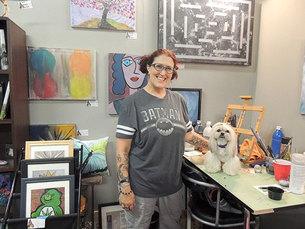 Kirsten Winger with her dog Gabi in her 'Flutterby Art' studio in CAL. (Photo by Ryan Pitkin)