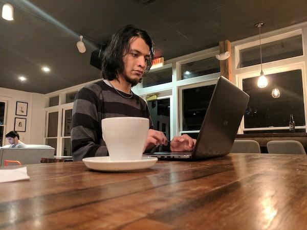 Carlos Miranda sits inside Summit Coffee on the Davidson College campus.