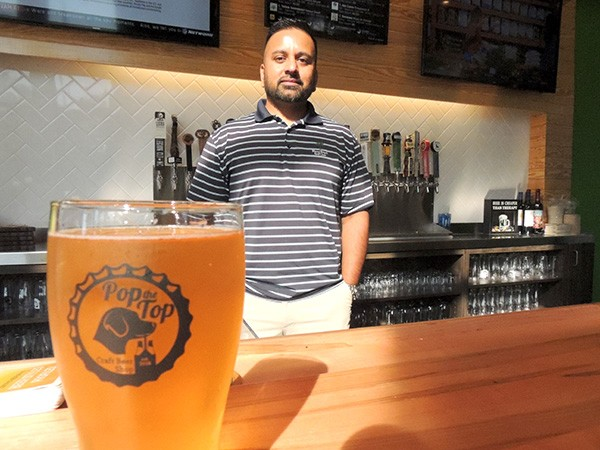 Ketan Patel at Pop the Top Craft Beer Shop. (Photo by Ryan Pitkin)