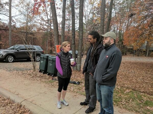 City council reps [from left] Julie Eiselt, Braxton Winston and Larken Egleston watch a Love Life Charlotte rally on December 2.
